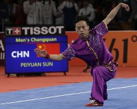 China's Peiyuan Sun perform during the Wushu games at the 18th Asian Games in Jakarta, Indonesia on Sunday, Aug. 19, 2018. Sun won gold. (AP Photo/Aaron Favila)