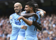 Manchester City's Sergio Aguero celebrates scoring his side's third goal of the game with David Silva, left, and Benjamin Mendy during the English Premier League soccer match between Manchester City and Huddersfield Town at the Etihad Stadium in Manchester, England, on Aug. 19, 2018. (AP Photo/Dave Thompson)