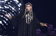 Madonna presents a tribute to Aretha Franklin at the MTV Video Music Awards at Radio City Music Hall in New York, on Aug. 20, 2018. (Photo by Chris Pizzello/Invision/AP)
