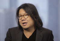 In this Aug. 25, 2017 photo, Singaporean novelist Kevin Kwan talks during an interview in Hong Kong. (AP Photo/Vincent Yu)