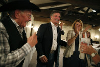Gubernatorial candidate and Wyoming Secretary of State Mark Gordon celebrates with supporters as poll numbers are finalized during Gordon's election night party at Bozeman Trail Steakhouse in Buffalo, Wyoming, on Aug. 21, 2018. (Josh Galemore/The Casper Star-Tribune via AP)