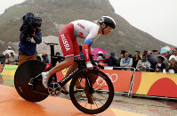 In this Aug. 10, 2016 photo, cyclist Olga Zabelinskaya of Russian rides at the start of the women's individual time trial event at the 2016 Summer Olympics in Pontal beach, Rio de Janeiro, Brazil. (AP Photo/Patrick Semansky)
