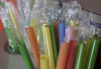 This July 17, 2018 file photo shows wrapped plastic straws at a bubble tea cafe in San Francisco. (AP Photo/Jeff Chiu)