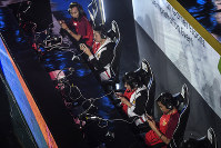 In this Aug. 26, 2018 photo, the Indonesian team competes in the eSports exhibition at the 18th Asian Games Arena of Valor, Britama Arena, Jakarta. (Dhemas Reviyanto,INASGOC via AP)