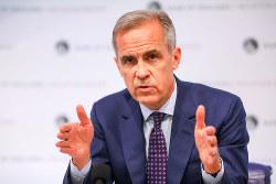 「不快なほど高リスク」と発言した英中銀のカーニー総裁 (bloomberg)