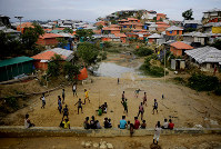 Rohingya refugees play at Balukhali Refugee Camp in Bangladesh, on Aug. 27, 2018. (AP Photo/Altaf Qadri)