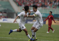 South Korea's Lee Seung-woo, left, celebrates his goal with teammate Son Heung-min after scoring during their men's semifinal soccer match against Vietnam at the 18th Asian Games in Bogor, West Java, Indonesia, on Aug. 29, 2018. (AP Photo/Lee Jin-man)