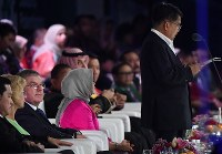 International Olympic Committee President Thomas Bach, third from left, listens to a speech by Indonesian Vice President Jusuf Kalla at the Asian Games closing ceremony at Gelora Bung Karno Stadium in Jakarta on Sept. 2, 2018. (Mainichi)