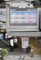 A large monitor shows a train service schedule at JR Osaka Station in Kita Ward in the city of Osaka in western Japan as powerful Typhoon Jebi approaches on Sept. 4, 2018. (Mainichi)