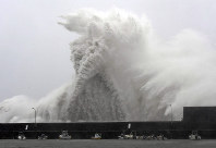 Large waves surge over a wall at a fishing port in Aki, Kochi Prefecture, in western Japan on the morning of Sept. 4, 2018, as powerful Typhoon Jebi approaches. (Mainichi)