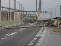 The bridge connecting Kansai International Airport island and mainland Osaka Prefecture is seen with extensive damage after the structure was struck by a tanker that was pushed by strong winds from Typhoon Jebi on Sept. 4, 2018. (Photo courtesy of the Japan Coast Guard)