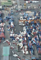 Containers are seen collapsed at Rokko Island in Kobe's Higashinada Ward in this photo taken from a Mainichi Shimbun helicopter on Sept. 5, 2018, after Typhoon Jebi roared through western Japan. (Mainichi)