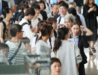 People are seen in a Hakodate Airport terminal building after flights were suspended due to an earthquake, on Sept. 6, 2018 in Hakodate, Hokkaido. (Mainichi)