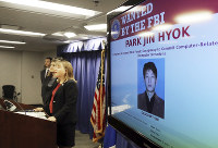 United States Attorney Tracy Wilkison announces a criminal complaint being filed against a North Korean national accused in a series of destructive cyberattacks around the world, at a news conference in Los Angeles on Sept. 6, 2018. (AP Photo/Reed Saxon)