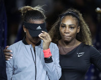 Naomi Osaka, of Japan, is hugged by Serena Williams after Osaka defeated Williams in the women's final of the U.S. Open tennis tournament, Saturday, Sept. 8, 2018, in New York. (AP Photo/Julio Cortez)