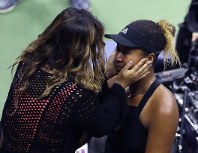 Naomi Osaka, of Japan, is hugged by her mom, Tamaki Osaka, after defeating Serena Williams is the women's final of the U.S. Open tennis tournament, Saturday, Sept. 8, 2018, in New York. (AP Photo/Seth Wenig)