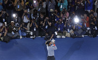Naomi Osaka, of Japan, holds the trophy after defeating Serena Williams in the women's final of the U.S. Open tennis tournament, Saturday, Sept. 8, 2018, in New York. (AP Photo/Julio Cortez)