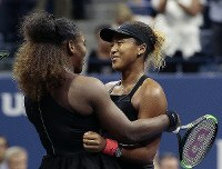 Naomi Osaka of Japan is hugged by Serena Williams after Osaka defeated Williams in the women's final of the U.S. Open tennis tournament on Sept. 8, 2018, in New York. (AP Photo/Andres Kudacki)