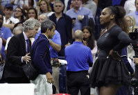 Chair umpire Carlos Ramos, second from left, is lead off the court by referee Brian Earley after Naomi Osaka, of Japan, defeated Serena Williams in the women's final of the U.S. Open tennis tournament, on Sept. 8, 2018, in New York. (AP Photo/Julio Cortez)