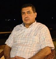 取材に応じるアズハル大(ガザ市)のアブサダ准教授=ガザ市で2018年9月4日、高橋宗男撮影