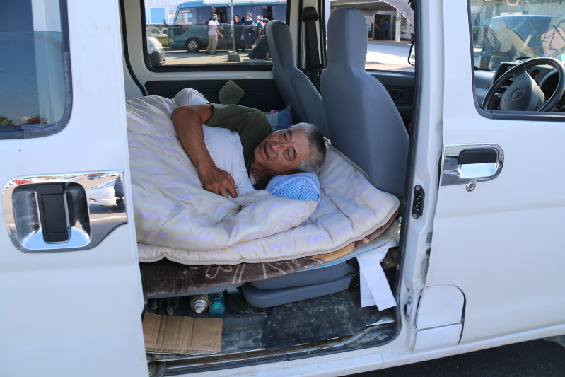 Earthquake Evacuee Kazuhiko Nishida Lies Down On A Futon Laid Out In The Back Of His Van Mukawa Hokkaido Sept 14 2018 Mainichi
