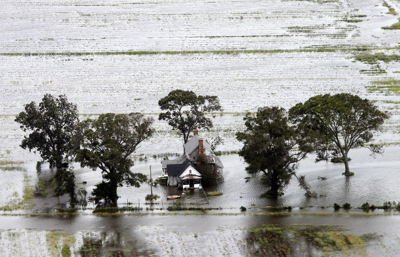 A farm house is surrounded by flooded fields from tropical storm Florence in Hyde County N.C. Saturday Sept. 15 2018