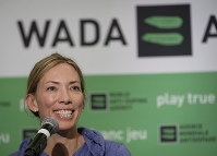 In this June 5, 2018, file photo, Beckie Scott, World Anti-Doping Agency athlete committee chairperson, Beckie Scott, speaks at a news conference following the agency's first Global Athlete Forum in Calgary, Alberta. (Jeff McIntosh/The Canadian Press via AP, File)