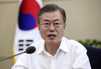 South Korean President Moon Jae-in speaks during a Cabinet meeting at the presidential Blue House in Seoul on Sept. 17, 2018. (Hwang Gwang-mo/Yonhap via AP)