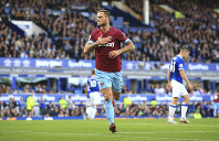 West Ham United's Marko Arnautovic celebrates scoring his side's third goal of the game, during the English Premier League soccer match between Everton and West Ham United, at Goodison Park, Liverpool, England, on Sept. 16, 2018. (Peter Byrne/PA via AP)