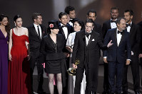 Amy Sherman-Palladino, front and center left, Daniel Palladino and the cast and crew of