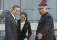 In this image made from video provided by Korea Broadcasting System (KBS), South Korean President Moon Jae-in, left, is welcomed by North Korean leader Kim Jong Un and his sister Kim Yo Jong upon arrival in Pyongyang, North Korea, on Sept. 18, 2018. (Korea Broadcasting System via AP)