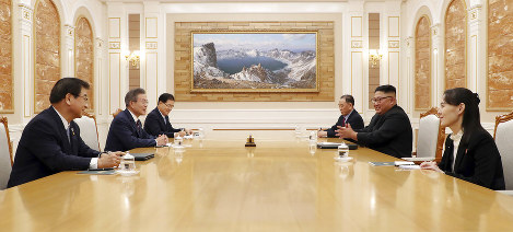 North Korean leader Kim Jong Un, right center, talks with South Korean President Moon Jae-in, left center, during their summit at the headquarters of the Central Committee of the Workers' Party in Pyongyang, North Korea on Sept. 18, 2018. (Pyongyang Press Corps Pool via AP)