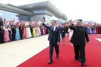 In this Sept. 18, 2018 photo, South Korean President Moon Jae-in and North Korean leader Kim Jong Un, right, wave during a welcome ceremony at Sunan International Airport in Pyongyang in North Korea. (Pyongyang Press Corps Pool via AP, File)
