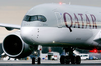 In this Jan. 15, 2015 file photo, a Qatar Airways jet arriving from Doha, Qatar, approaches the gate at the airport in Frankfurt, Germany. (AP Photo/Michael Probst)
