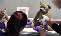 In this Sept. 13, 2018 photo, gallery stylists position antique Winnie the Pooh bears while preparing the