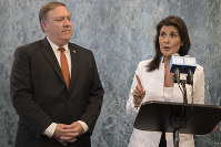 In this July 20, 2018 file photo, U.S. Secretary of State Mike Pompeo, left, and American Ambassador to the United Nations Nikki Haley speak to reporters at the United Nations headquarters. (AP Photo/Mary Altaffer)