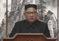 In this image made from video provided by Korea Broadcasting System (KBS), North Korean leader Kim Jong Un speaks during a joint press conference with South Korean President Moon Jae-in in Pyongyang, North Korea Wednesday, Sept. 19, 2018. (Korea Broadcasting System via AP)