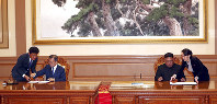 South Korean President Moon Jae-in, second from left, and North Korean leader Kim Jong Un, second from right, sign documents at the Paekhwawon State Guesthouse in Pyongyang, North Korea, on Sept. 19, 2018. (Pyongyang Press Corps Pool via AP)