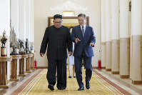 South Korean President Moon Jae-in, right, and North Korean leader Kim Jong Un walk together at the Paekhwawon State Guesthouse in Pyongyang, North Korea, on Sept. 19, 2018. (Pyongyang Press Corps Pool via AP)