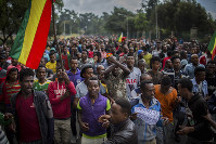 Thousands of protestors from the capital and those displaced by ethnic-based violence over the weekend in Burayu demonstrate to demand justice from the government in Addis Ababa, Ethiopia Monday, Sept. 17, 2018. (AP Photo/Mulugeta Ayene)