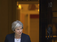Britain's Prime Minister Theresa May waits to greet her Maltese counterpart Joseph Muscat to 10 Downing Street in London ahead of talks, on Sept. 17, 2018. (Dominic Lipinski/PA via AP)