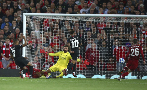 PSG's Kylian Mbappe, left, scores his sides second goal during the Champions League Group C soccer match between Liverpool and Paris-Saint-Germain at Anfield stadium in Liverpool, England, on Sept. 18, 2018. (AP Photo/Dave Thompson)