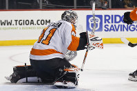 Philadelphia Flyers goaltender Anthony Stolarz deflects the puck with his stick on a shot by the New York Islanders in the second period of a preseason NHL hockey game on Sept. 18, 2018, in New York. (AP Photo/Adam Hunger)