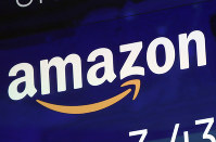 In this July 27, 2018 file photo, the logo for Amazon is displayed on a screen at the Nasdaq MarketSite. (AP Photo/Richard Drew)