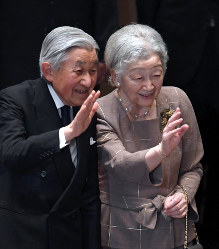 In this June 25, 2018 photo, Emperor Akihito, left, and Empress Michiko wave to the audience at a concert for children who are suffering from cancer and their families in Tokyo's Shibuya Ward. (Mainichi/Kimi Takeuchi)