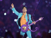 In this Feb. 4, 2007, file photo, Prince performs during the halftime show at the Super Bowl XLI football game at Dolphin Stadium in Miami. (AP Photo/Chris O'Meara)