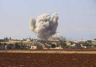 This file photo released on Sept 10, 2018 by the Syrian Civil Defense group known as the White Helmets, shows smoke rising from a Syrian government airstrike, in Hobeit village, near Idlib, Syria. (Syrian Civil Defense White Helmets via AP)
