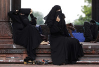 In this Aug. 22, 2017 file photo, Indian Muslim women rest inside Jama Masjid mosque in New Delhi, India. (AP Photo/Tsering Topgyal)