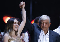 In this June 27, 2018 file photo, presidential candidate Andres Manuel Lopez Obrador and pop singer Belinda acknowledge the crowd during his closing campaign rally at Azteca stadium in Mexico City. (AP Photo/Marco Ugarte)