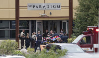 Emergency personnel arrive on the scene of a shooting at a software company in Middleton, Wis., on Sept. 19, 2018. (Steve Apps/Wisconsin State Journal via AP)
